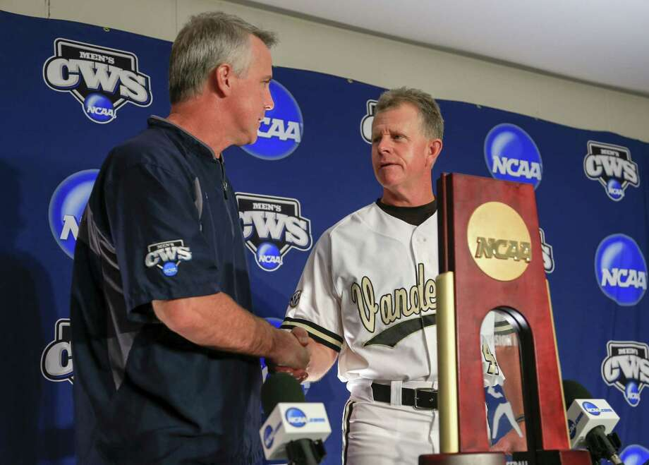 Virginia coach Brian O'Connor, left, and Vanderbilt coach Tim Corbin shake hands at the beginning of a news conference in Omaha, Neb., on Sunday. Photo: Nati Harnik — The Associated Press  / AP