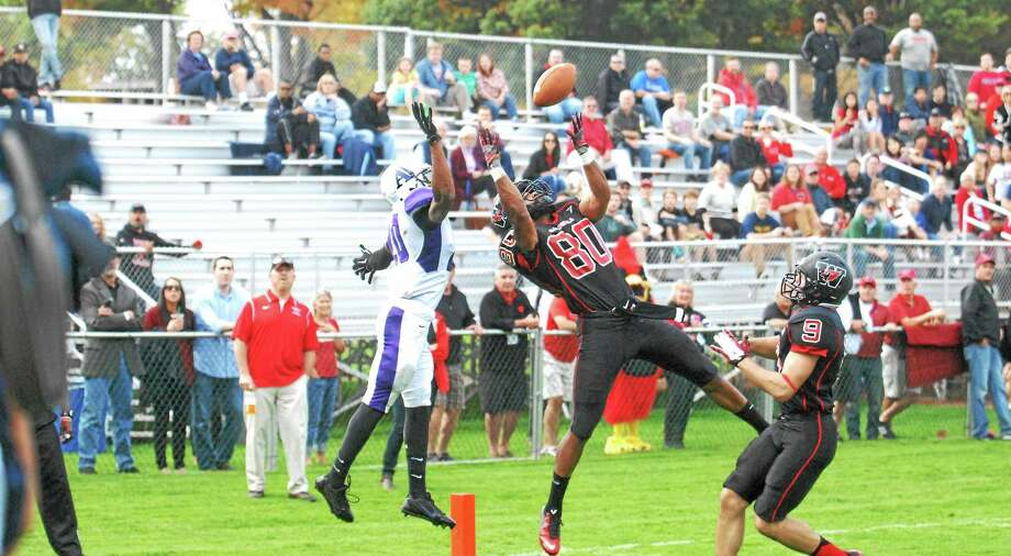 Wesleyan senior wide receiver Jay Fabien tries to come up with a catch at the end of the first half. Photo: Jimmy Zanor — The Middletown Press