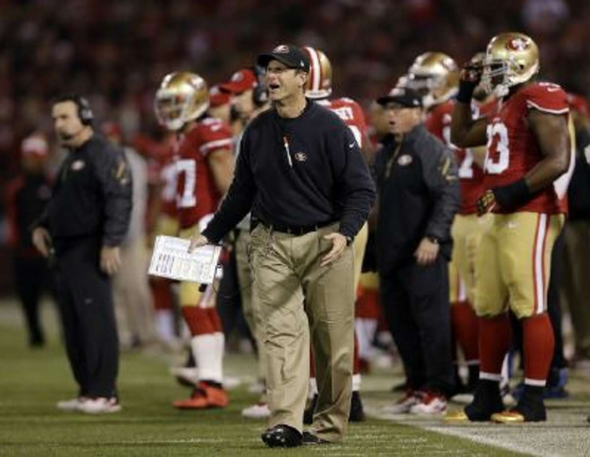 Jim Harbaugh was in good spirits Monday. Doesn't he look like it?