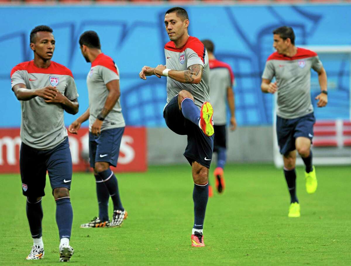 The United States' Clint Dempsey, center, works out during a training session.