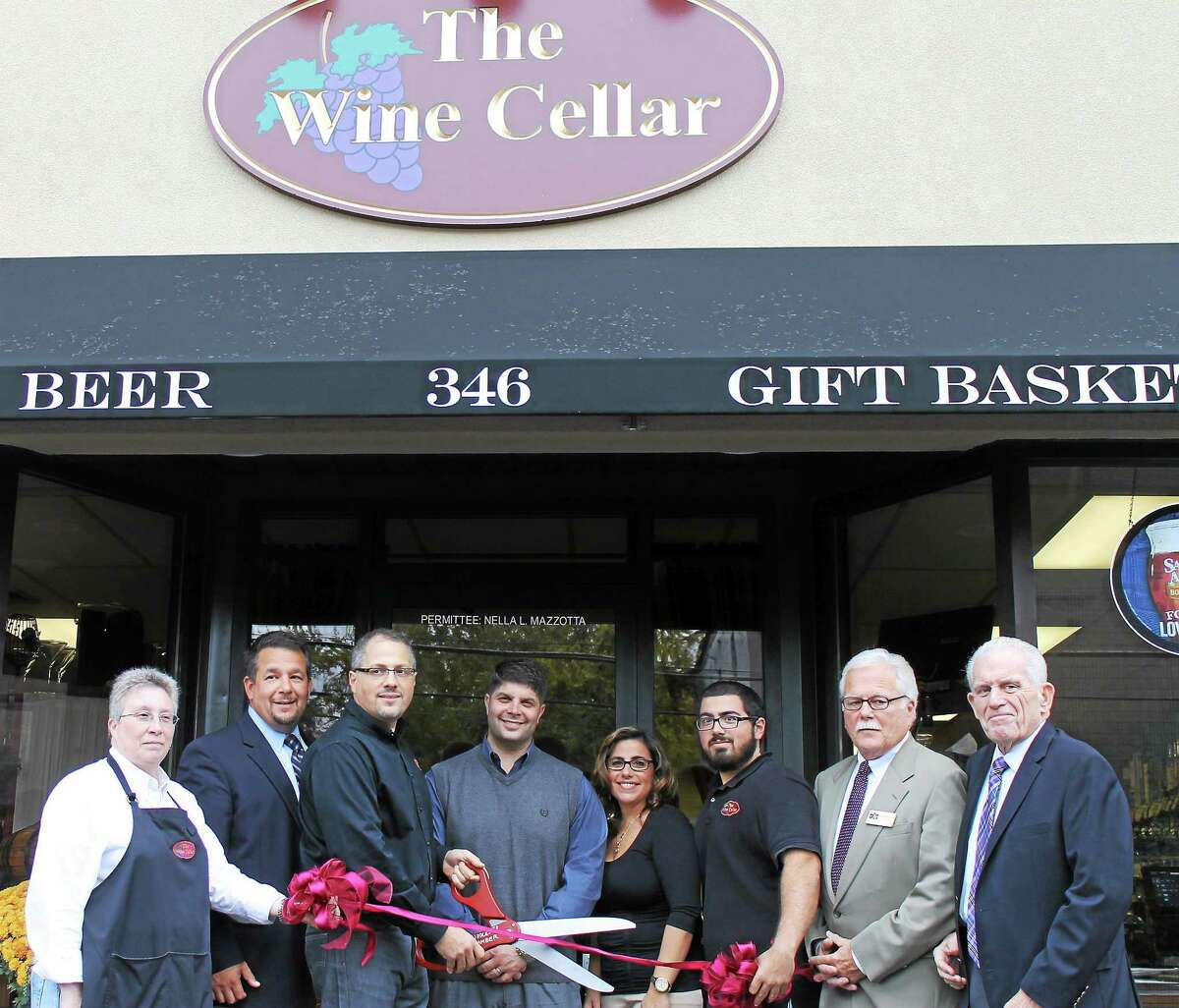 From left are: Richelle Carlone of The Wine Cellar, Middlesex County Chamber of Commerce Chairman Rich Carella, Mario Mazzotta of The Wine Cellar, Mayor Dan Drew, Nella Mazzotta of The Wine Cellar, Gino Mazzotta of The Wine Cellar, South Middletown Division Chairman Paul Dodge and Chamber President Larry McHugh.