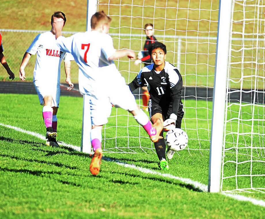 Valley Regional senior Nick Lepore tries to redirect a cross against Portland keeper Kenny Pho in Thursday's Shoreline Conference battle. Photo: Jimmy Zanor — The Middletown Press
