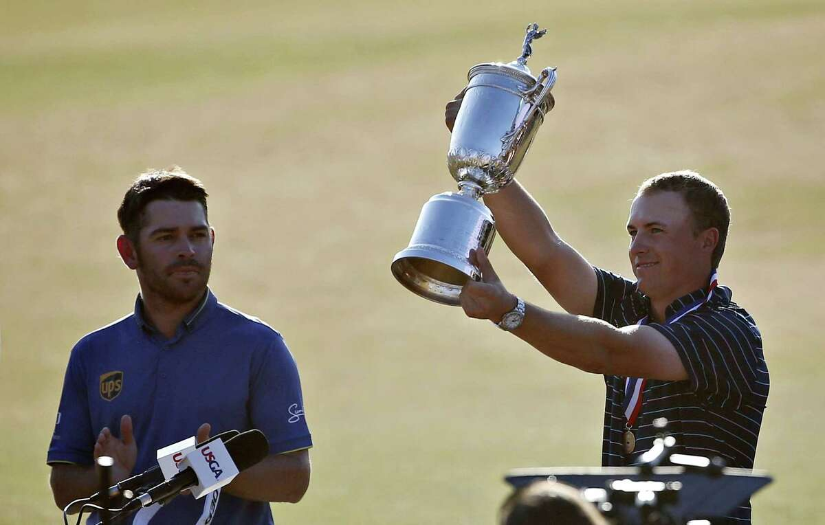 Jordan Spieth holds up the trophy after winning the U.S. Open on Sunday.