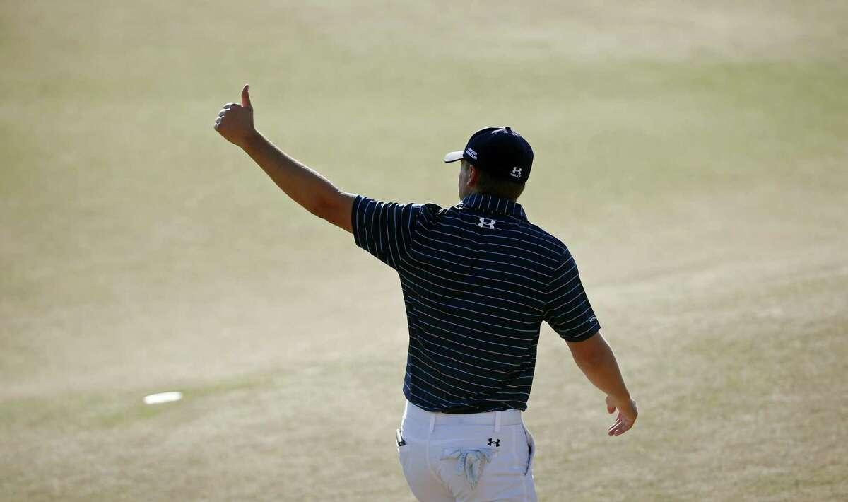 Jordan Spieth walks off the green after the final round of the U.S. Open on Sunday.