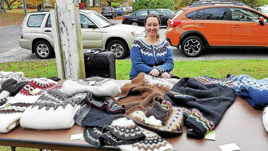 Soley Branigan, a designer from Olafsfjordur, a city in the north of Iceland, sold her homemade, cozy-looking sweaters at an outdoor table at the annual Iceland Affair event at the Winchester Grange Saturday. Photo: By N.F. Ambery — Special To The Register Citizen