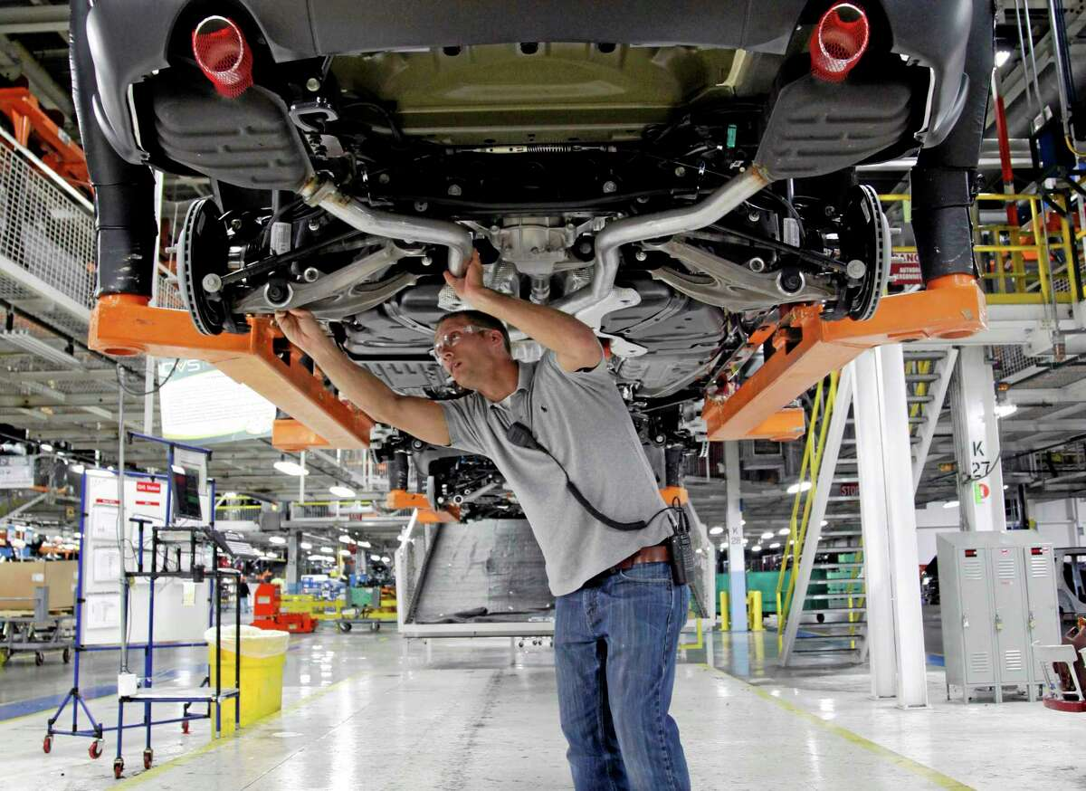A chassis assembly line supervisor checks a vehicle on the assembly line at the Chrysler Jefferson North Assembly plant in Detroit.