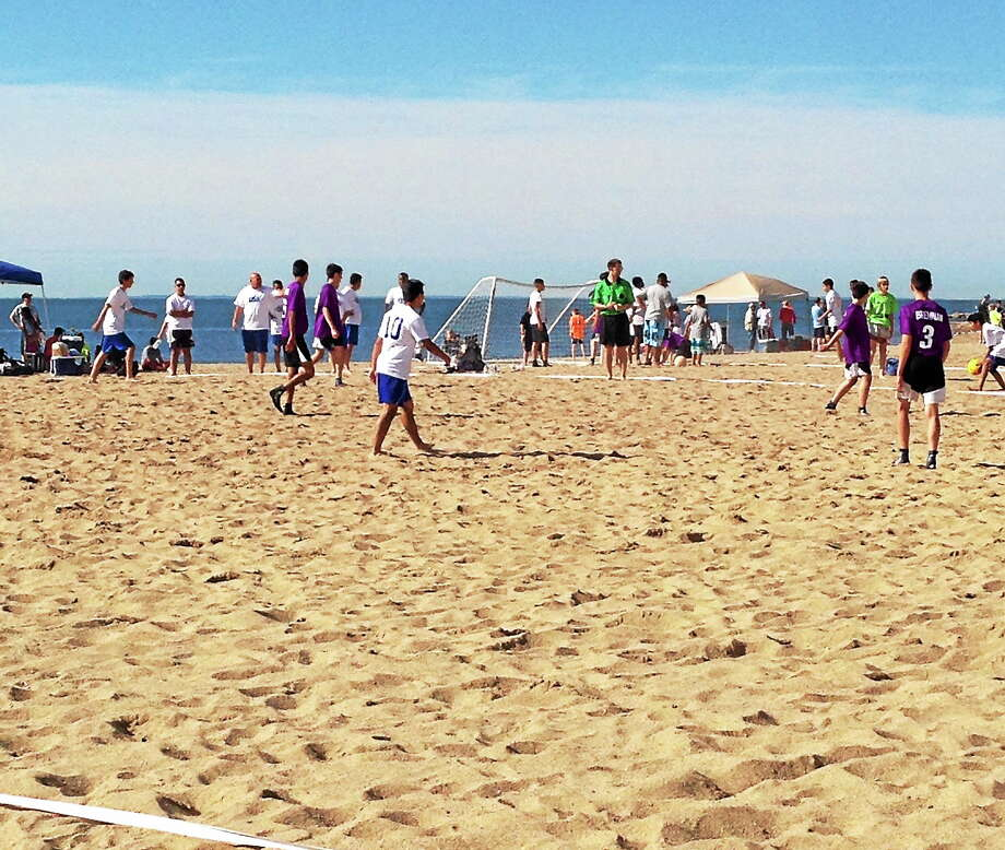 Youth soccer teams play at the 2014 Soccer Resort New England Beach Blitz on West Haven Beach. Teams play for 30 minutes on a 30-by-40 yard field. Photo: Kristin Stoller - New Haven Register