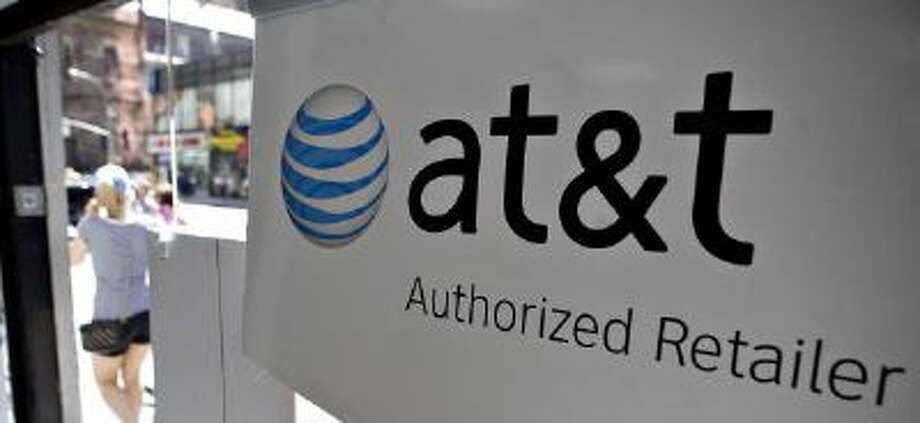 An AT&T logo hangs in the front window. Photo: Bloomberg Via Getty Images / 2010 Bloomberg