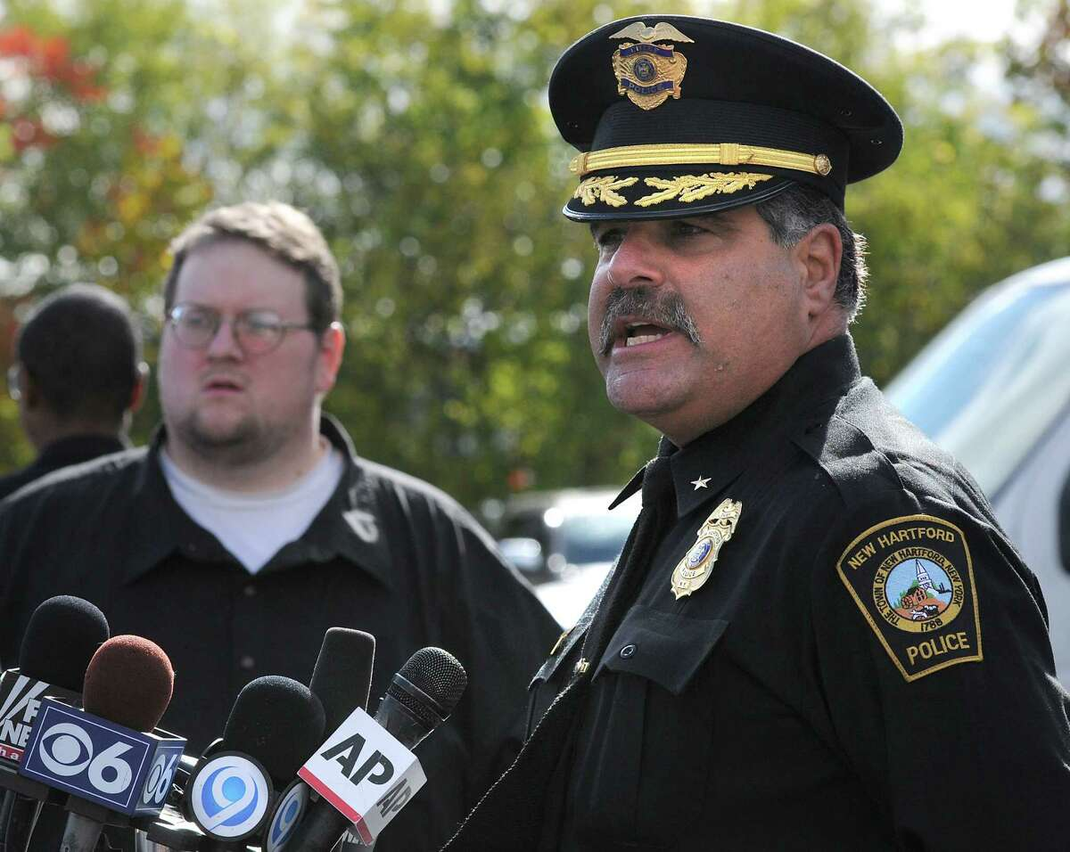 New Hartford Police Chief Michael Inserra speaks with members of the press shortly before a preliminary felony hearing for those charged in the fatal beating of 19-year-old Lucas Leonard, and the attack on his 17-year-old brother, Christopher Leonard, Friday, Oct. 16, 2015, in New Hartford, N.Y. Their parents, Bruce and Deborah Leonard, were charged with manslaughter in Lucas' death. Four other adults were charged with assault in the younger brother's beating, including the victims' sister.