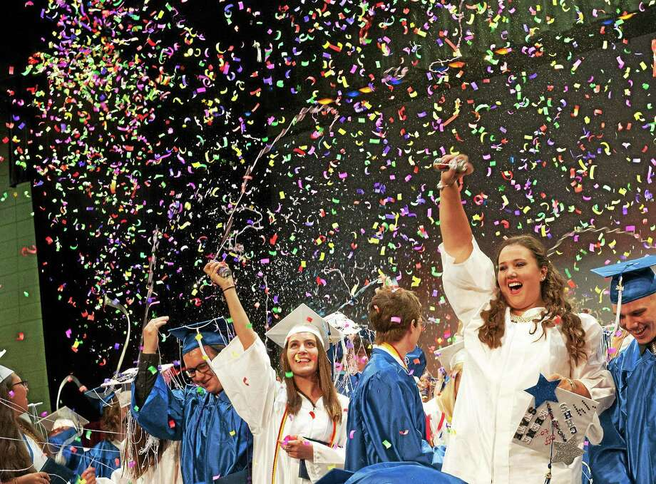 In this 2014 photo, members of Coginchaug Regional High's graduating class mark the pinnacle of their four years at the school that serves residents of Durham and Middlefield. Photo: File Photo  / RAY SHAW
