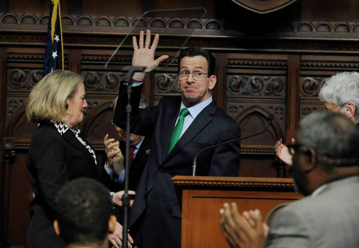 """Connecticut Gov. Dannel P. Malloy waves after delivering his budget address to the senate and house inside the Hall of the House at the State Capitol on Wednesday in Hartford. While acknowledging the state's economy continues to recover, Malloy told a joint session of the General Assembly that """"significant investment"""" is still needed to improve highways, bridges and rail over the next three decades to improve economic development and quality of life."""