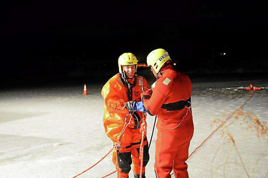 The Haddam Volunteer Fire Co. conducted ice rescue training at the Higganum Reservoir on Dec. 16. Pictured are ice rescue instructor Jay Selmer, left, and Lt. Richard Zanelli. Photo: Olivia Drake — Special To The Press