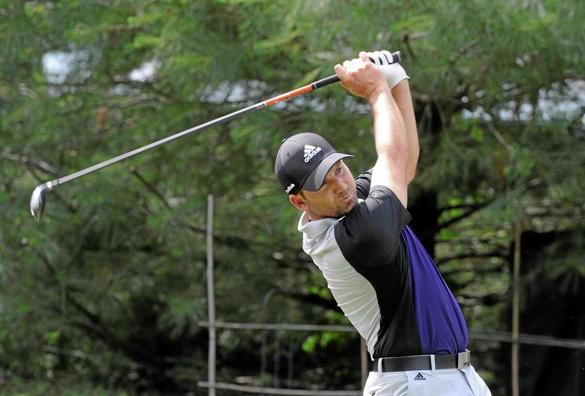 Sergio Garcia, of Spain, watches his drive on the 10th hole during the first round of the Travelers Championship golf tournament in Cromwell, Conn., Thursday, June 19, 2014. (AP Photo/Fred Beckham)