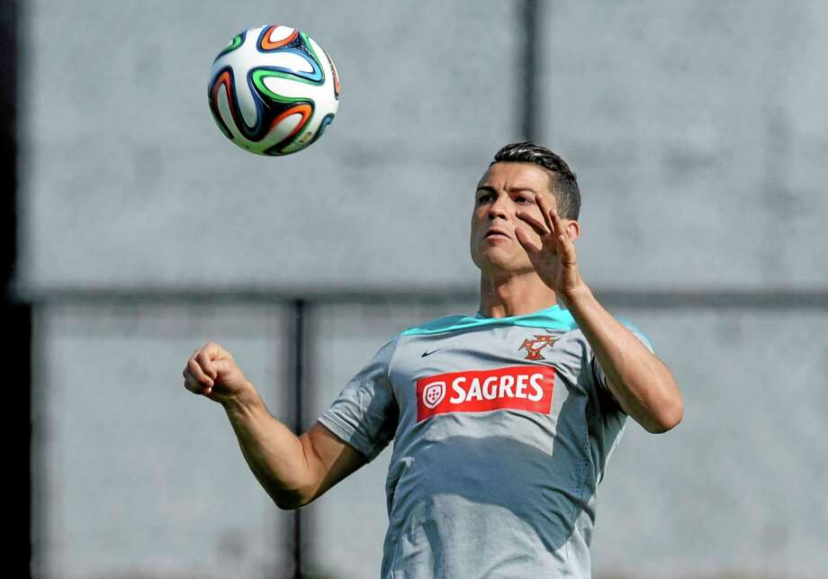 Cristiano Ronaldo controls the ball during a Portugal training session on Thursday in Campinas, Brazil. Photo: Paulo Duarte — The Associated Press  / AP