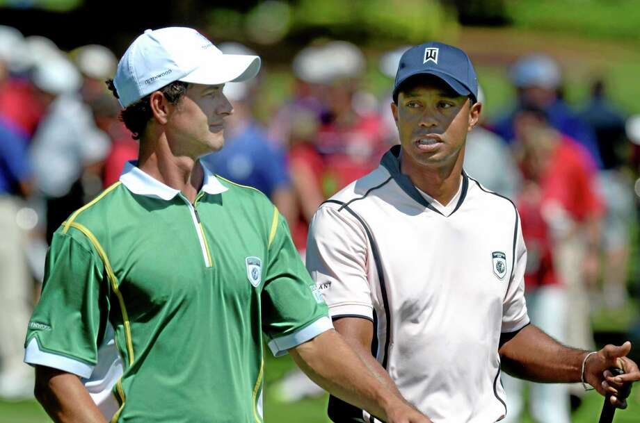 Adam Scott, left, narrowly beat out Tiger Woods as the male player of the year in voting by the Golf Writers Association of America. Photo: Phelan M. Ebenhack — The Associated Press  / FR121174 AP
