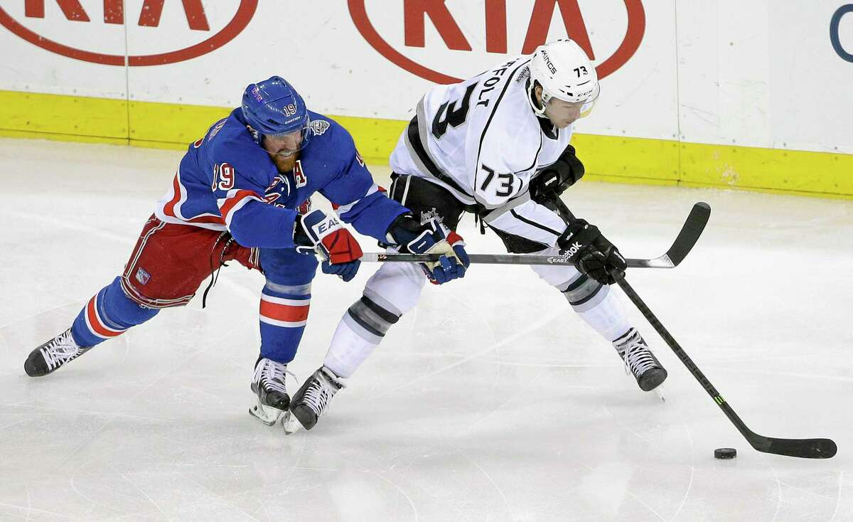 Rangers center Brad Richards (19) vies for the puck against Los Angeles Kings center Tyler Toffoli (73) in the first period of Game 4 of the Stanley Cup finals on June 11 in New York.