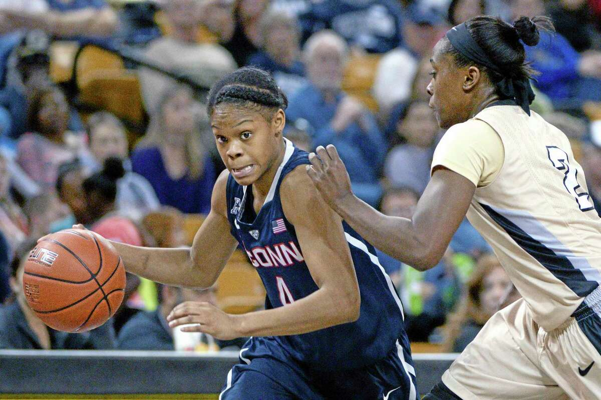 UConn guard Moriah Jefferson drives past Central Florida's Andrea Hines during the second half of the top-ranked Huskies' 77-49 win on Wednesday in Orlando, Fla.
