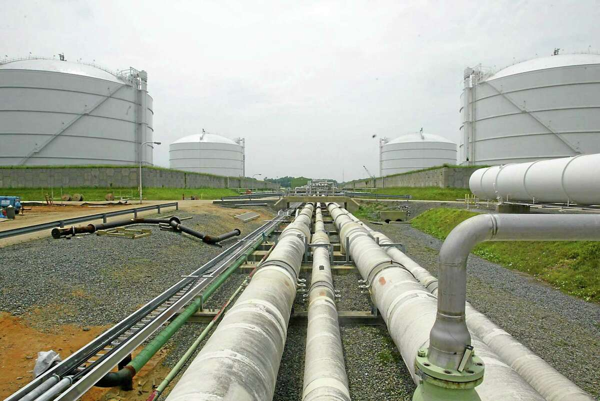 Pipelines running from the offshore docking station to four liquefied natural gas tanks are shown. The falling price of oil and gas has left China the only customer for Turkmenistan's gas, and revenue is falling.
