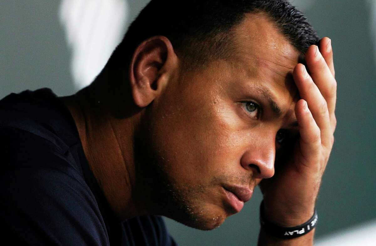 New York Yankees third baseman Alex Rodriguez wipes sweat from his brow as he sits in the dugout before a game at the Baltimore Orioles on Sept. 11, 2013.