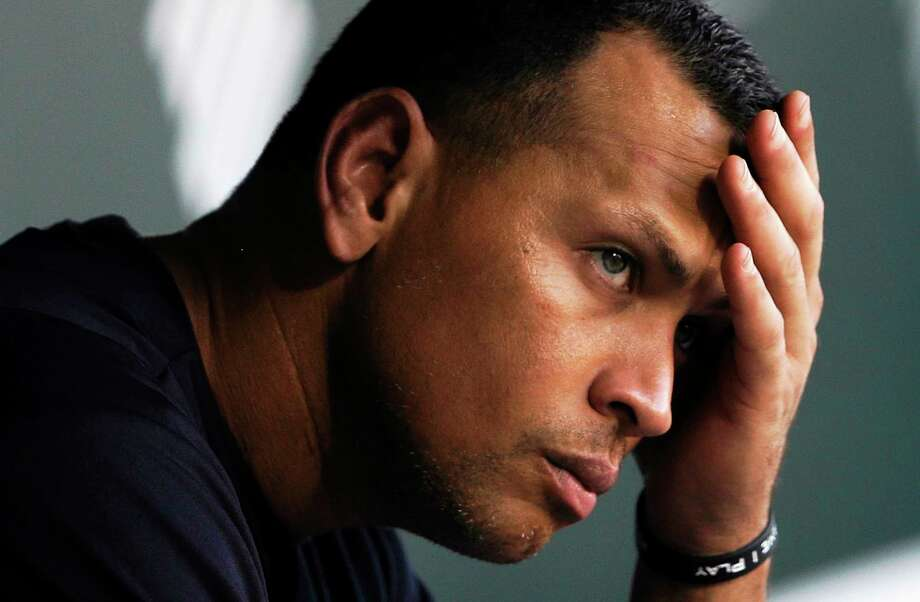 New York Yankees third baseman Alex Rodriguez wipes sweat from his brow as he sits in the dugout before a game at the Baltimore Orioles on Sept. 11, 2013. Photo: Patrick Semansky — The Associated Press  / AP2013
