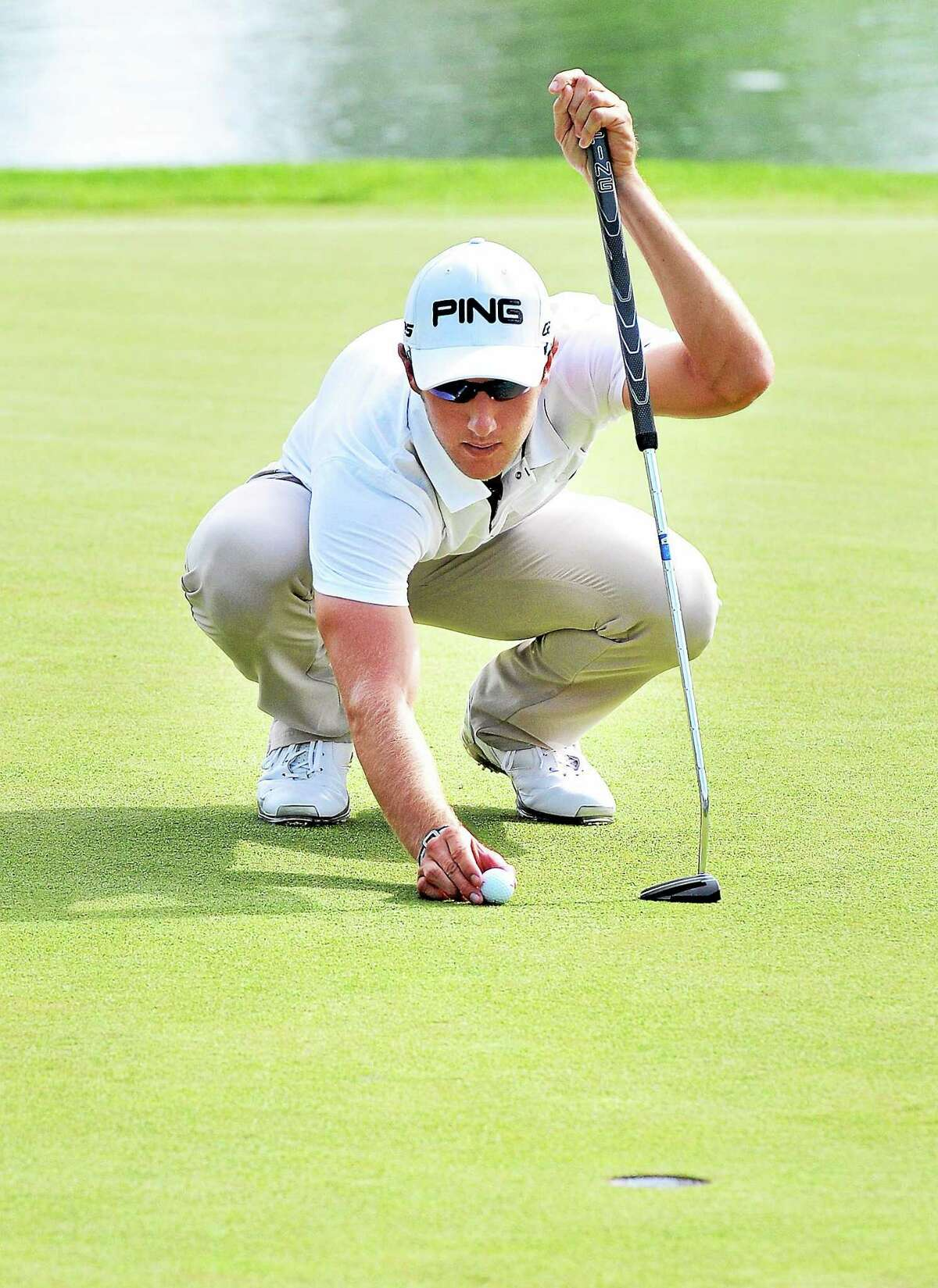 Derek Ernst places his ball on the 17th hole during the second round of the Travelers Championship on Friday in Cromwell.