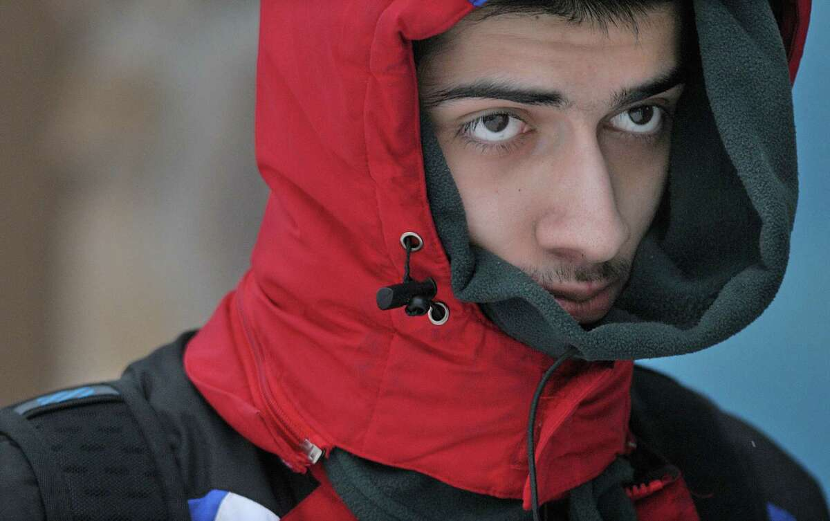 Wesleyan freshman Ali Jamali, an international student from Iran majoring in mathematics and computer science, braves the cold Thursday afternoon on Main Street in the North End of Middletown. Heavy snow, strong winds and very cold wind chills from 5 below to near 10 below zero is expected today. A winter storm warning remains in effect until 1 p.m.