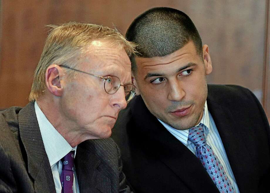 In this Friday, Feb. 7, 2014, file photo, former New England Patriots football player Aaron Hernandez, right, speaks to his attorney Charles Rankin during a hearing at Bristol Superior Court, in Fall River, Mass. Photo: AP File Photo/The Boston Globe, Jonathan Wiggs, Pool  / Pool The Boston Globe