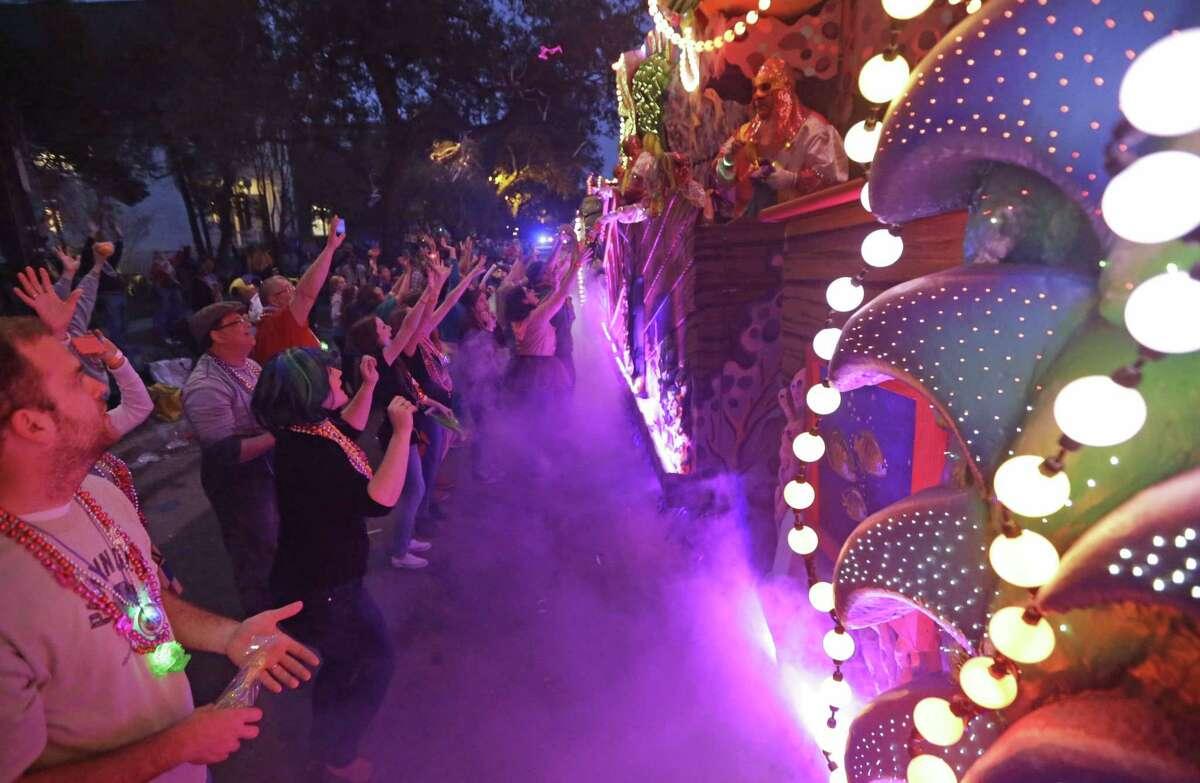 The Krewe of Proteus Mardi Gras parade rolls down Napoleon Aveune in New Orleans, Monday. The day is known as Lundi Gras, the day before Mardi Gras.