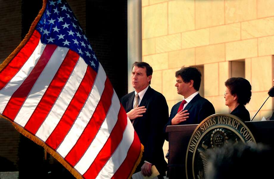 FILE- In this Nov. 14, 2005, file photo, U.S. Southern District Judge Andrew S. Hanen, left, joins with Filemon B. Vela, Jr. and Blanca Vela for the Pledge of Allegiance during the United States Courthouse naming ceremony in Brownsville, Texas. Hanen temporarily blocked President Barack Obamaís executive action on immigration Monday, Feb. 16, 2015, giving a coalition of 26 states time to pursue a lawsuit that aims to permanently stop the orders. (AP Photo/The Brownsville Herald, Brad Doherty, File) Photo: AP / Brownsville Herald