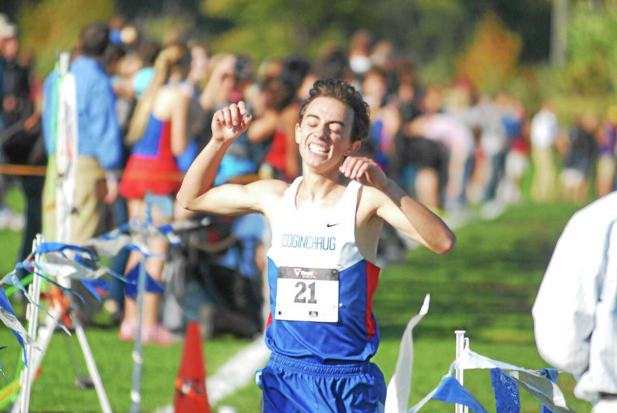 Coginchaug senior Christian Alberico is elated after winning the Shoreline Conference championship in a time of 15:58.9.