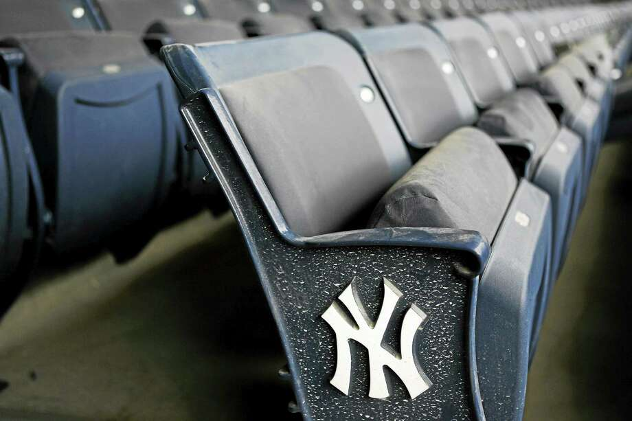 Register columnist Chip Malafronte had an unforgettable moment at Yankee Stadium on Thursday when a stranger decided to give him and his son an early Father's Day present with a free pair of pricey seats for the Yankees-Marlins game. Photo: The Associated Press File Photo  / AP2009