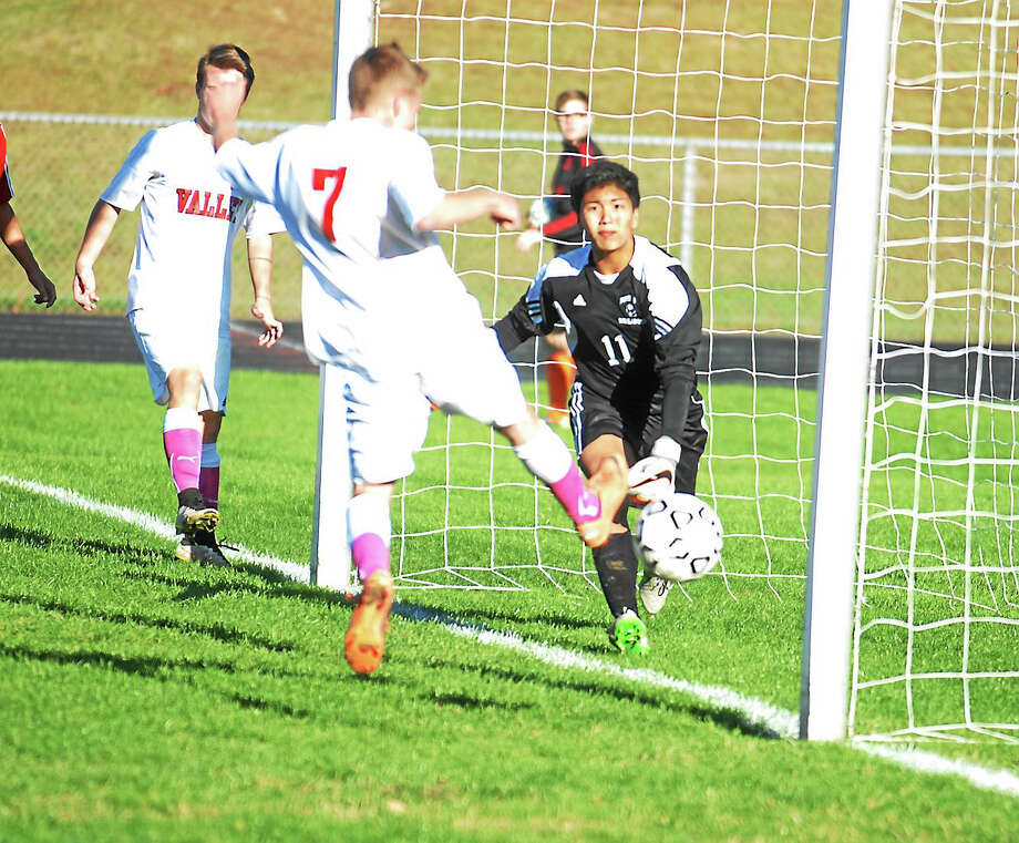 Jimmy Zanor - The Middletown PressValley Regional senior Nick Lepore tries to redirect a cross against Portland keeper Kenny Pho in Thursday's Shoreline Conference battle. Photo: Journal Register Co.