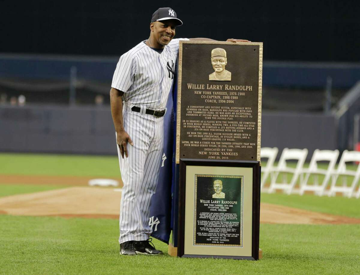Willie Randolph poses for photograph with a plaque he was awarded during opening ceremonies for the Old-Timers' Day game Saturday at Yankee Stadium.