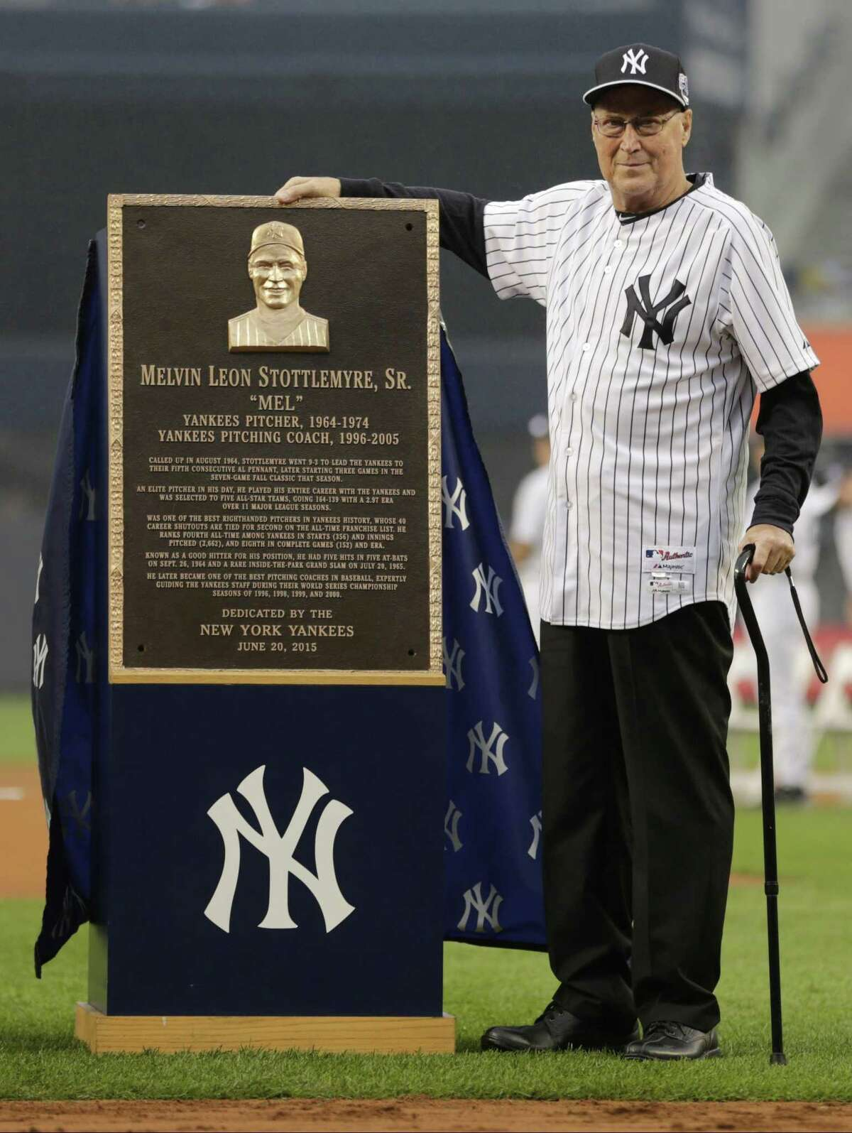 Mel Stottlemyre poses with his plaque.