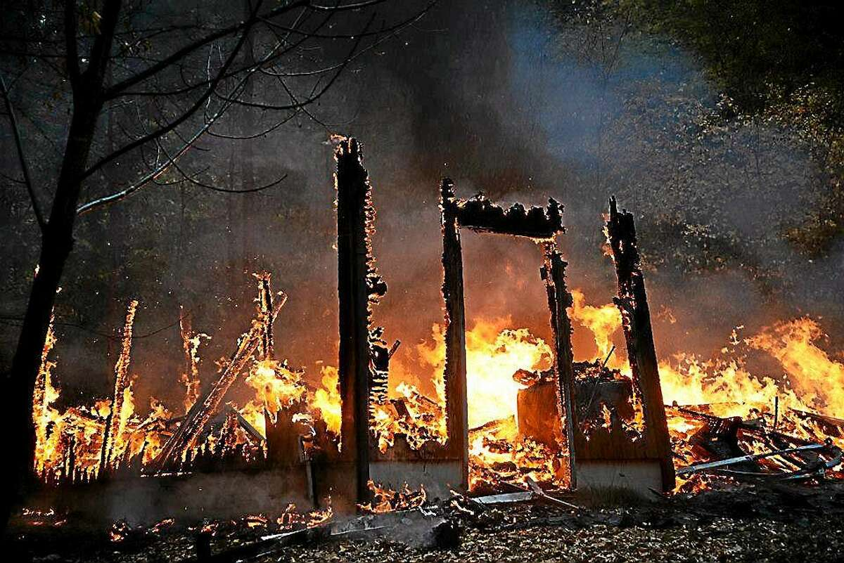 The brother of a Higganum homeowner is facing arson and burglary charges in connection with a savage fire that destroyed a raised ranch at 575 Candlewood Road Thursday morning.