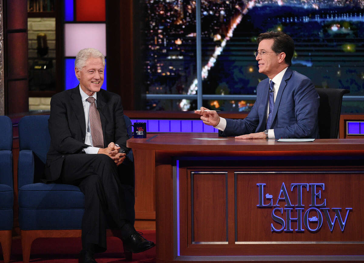 """In this image released by CBS, former President Bill Clinton, left, appears with host Stephen Colbert during a taping of """"The Late Show with Stephen Colbert,"""" airing Oct. 6, 2015 in New York."""