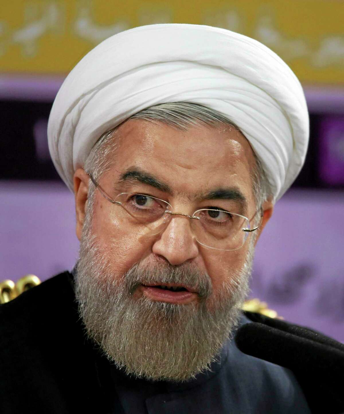 Iranian President Hassan Rouhani speaks during a press conference in Tehran, Iran, Saturday. Rouhani says the international sanctions regime has crumbled and will not be rebuilt even if Iran and world powers fail to reach a final nuclear deal by a July 20 deadline. Iran and the five permanent members of the U.N. Security Council plus Germany reached an interim deal in November that limited Iran's uranium enrichment program in exchange for the easing of some sanctions.