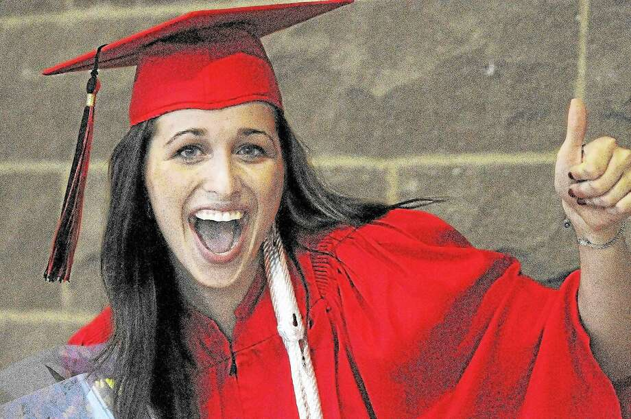 Laura Wall gives a thumbs up to family and friends following graduation at Portland High School in this 2013 file photo. Photo: Catherine Avalone — The Middletown Press  / TheMiddletownPress