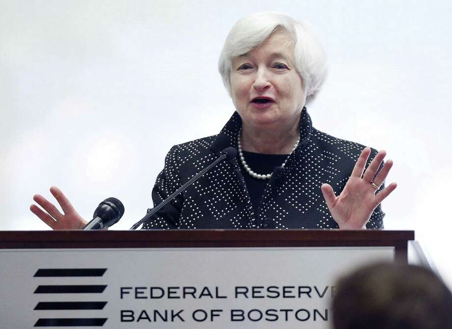 Federal Reserve Chairman Janet Yellen reacts as technicians work to resolve a computer problem during her speech at a conference on economic opportunity at the Federal Reserve Bank in Boston, Friday, Oct. 17, 2014. (AP Photo/Michael Dwyer) Photo: AP / AP
