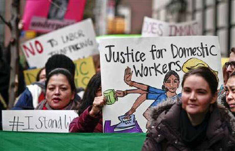 Members and supporters from a coalition of organizations supporting domestic workers rally Dec. 20 outside the Indian Consulate in New York. Photo: AP / AP