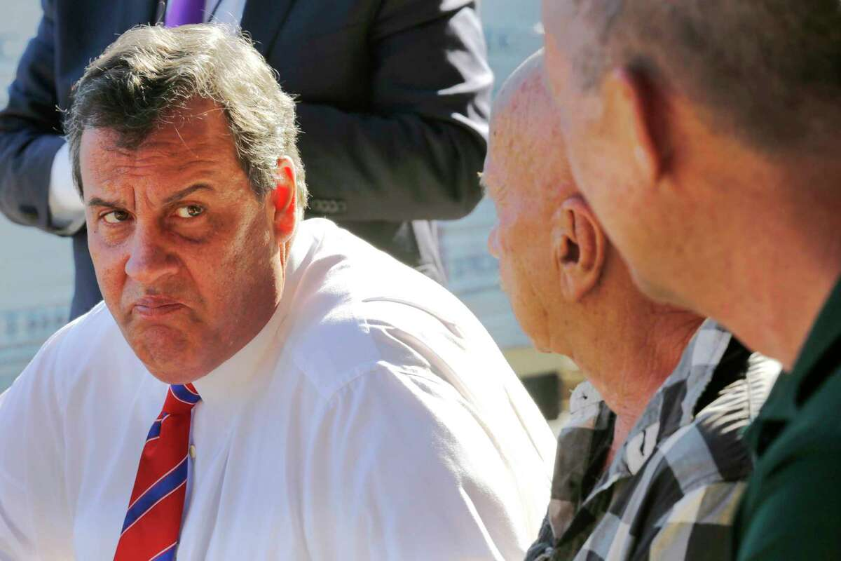 In this Oct. 7, 2015, photo, Republican presidential candidate Gov. Chris Christie, R-N.J., talks with employees during a campaign stop at East Coast Lumber in East Hampstead, N.H. Despite single-digit poll numbers, New Hampshire Republicans tell Chris Christie: Keep going.