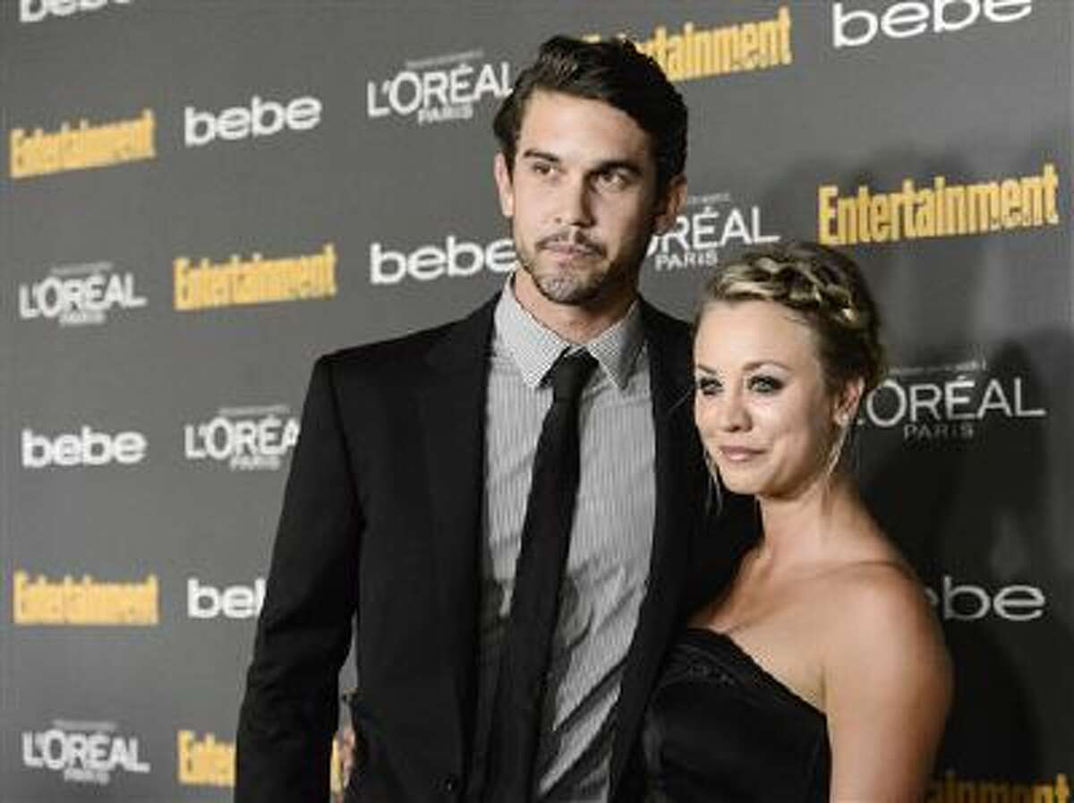 This Sept. 20, 2013 file photo shows actress Kaley Cuoco, right, and Ryan Sweeting at the 2013 Entertainment Weekly Pre-Emmy Party in Los Angeles.