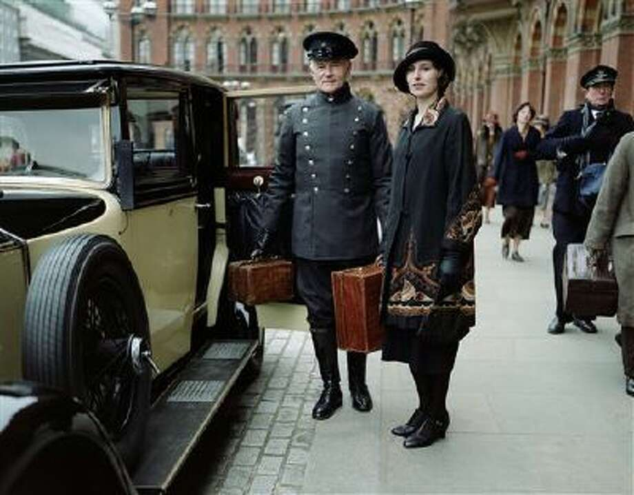 "This photo released by PBS and Carnival Film and Television Limited shows Laura Carmichael as Lady Edith in a scene from season four of the Masterpiece TV series, ""Downton Abbey."" As it returns for its much-awaited fourth season, ""Downton Abbey"" remains a series about elegance, tradition and gentility, and the pressures of preserving them. The show premieres Sunday, January 5, 2014 at 9 pm ET on PBS. Photo: AP / PBS"