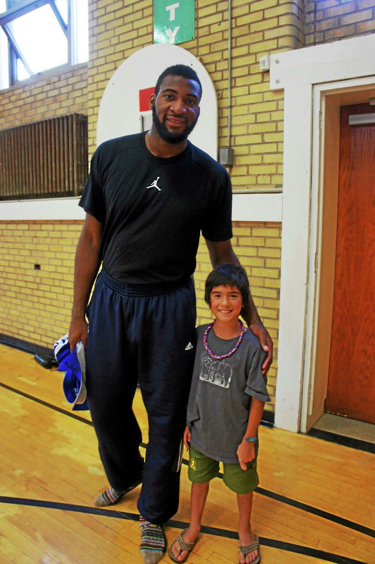 Detroit Pistons player Andrew Drummond visits with one of the Middletown YMCA's younger members during a recent visit to his favorite hometown court.