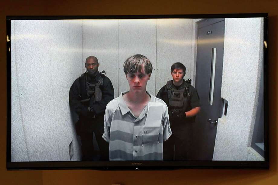 Dylann Roof appears Friday, June 19, 2015, at a bond hearing court in North Charleston, S.C. Roof is charged with nine counts of murder and firearms charges in the shooting deaths Wednesday night at Emanuel African Methodist Episcopal Church in downtown Charleston. (Grace Beahm/The Post And Courier via AP) Photo: AP / The Post and Courier