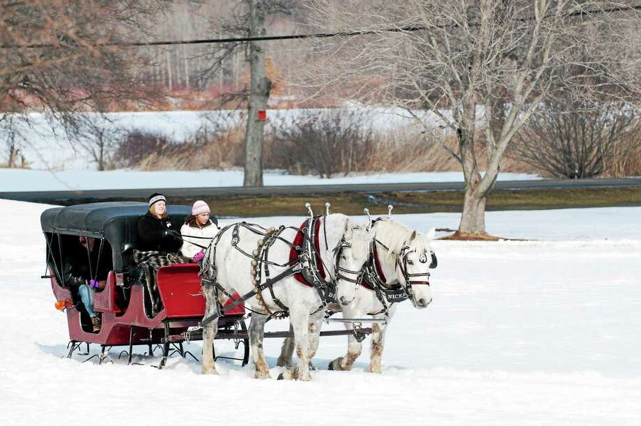 Contributed photos Horse-drawn carriage rides are just one of the many attractions that will be found at the Lyman Orchards winter festival. Photo: Journal Register Co.