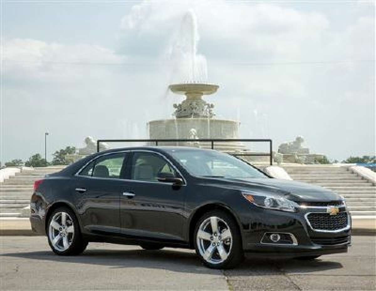 This May 31, 2013, photo provided by General Motors shows the 2014 Chevrolet Malibu in Detroit, Mich. The four-door 2014 Malibu can deliver 14 percent better mileage in city driving, in particular, than last year?s Malibu, according to Chevrolet.