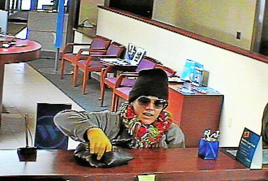 The suspect in Tuesday's Webster Bank robbery looks similar to the woman who reportedly demanded money from financial institutions in Vernon, East Hartford, Wethersfield and Wallingford on surveillance video, Cromwell police say. Photo: Courtesy Cromwell Police