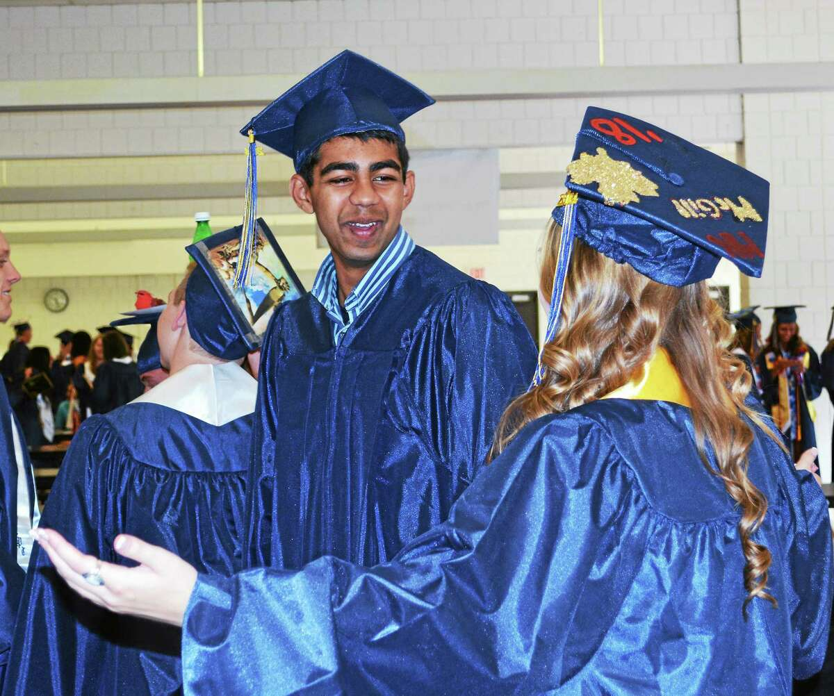 The 154 members of the Haddam-Killingworth High School Class of 2014 graduated Friday in a ceremony that featured an award-winning children's author and alumni as speaker.