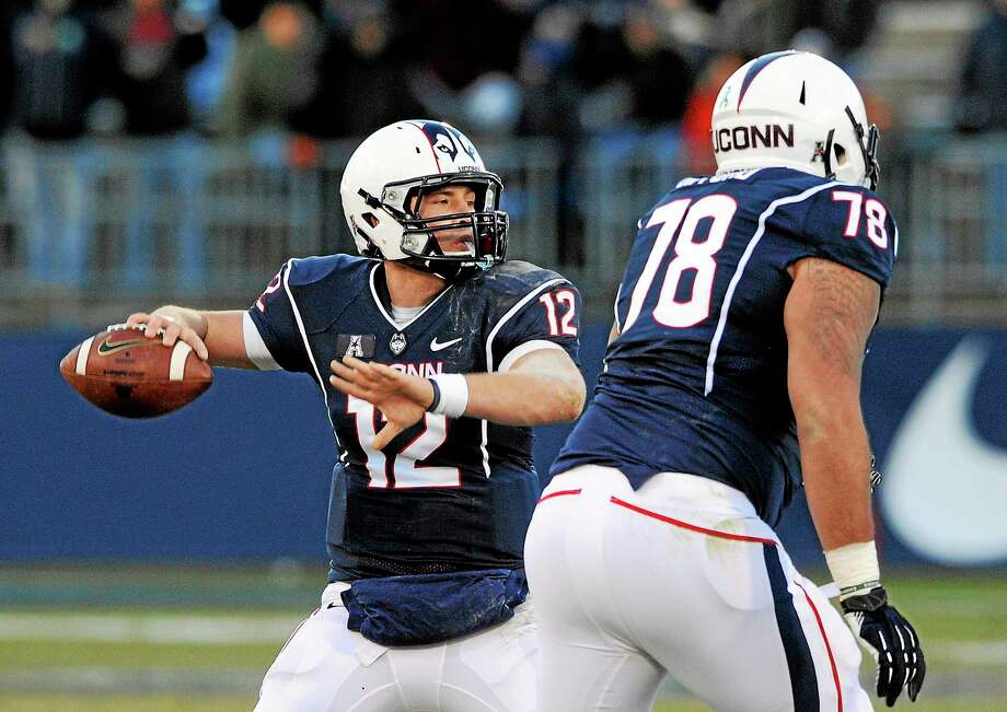 UConn quarterback Casey Cochran has one less teammate on the depth chart behind him now that Kivon Taylor is no longer enrolled at the school and intends to transfer. Photo: Fred Beckham — The Associated Press File Photo  / FR153656 AP